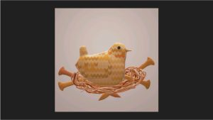 This image shows the 3D bird in 3D rendering of a nest of yarn and the knitting needles from the last image.