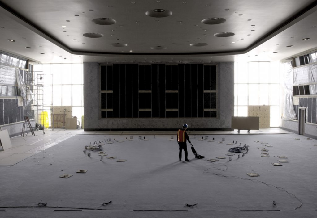 Man vacuuming during renovation of Security Council Chamber, UN Headquarters New York, 2017