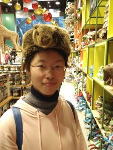 Ziling wearing a beaver hat in a store